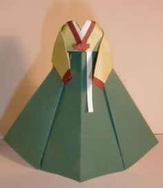 Most popular tags for this image include: dress, origami and Paper