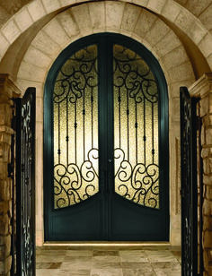 Arched Double Front Doors spanish arched double entry doors | double iron door with transom