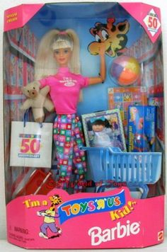 Im a Toys R Us Kid Barbie by Mattel, http://www.amazon.com/dp/B000HJWR82/ref=cm_sw_r_pi_dp_-CRNrb1RFWKST