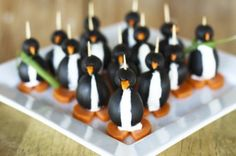 Black Olive Penguins  Ingredients  16 slices(thin Slices) Of The Fat End Of A Peeled Carrot  1 can(about 6 Oz. Can) Small Pitted Black Olives, Drained (You Only Need About 16 Of Them)  1 can(about 6 Oz. Can) Colossal Or Jumbo Pitted Black Olives, Drained (about 16)  4 ounces, weightNeufchatel (1/3 Less Fat) Cream Cheese  8 wholeGreen Onions, The Long Green Part Only  16 wholeToothpicks