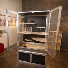 Very cool wooden chinchilla cage setup. It has plenty of space, lots of ledges and I love the colors.