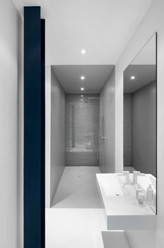 Bright white-and-gray bathroom.