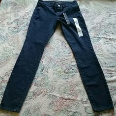 """NWOT Rich & Skinny skinny jeans NWOT Rich & Skinny dark wash skinny jeans with stretch.  Has some tags just not price tag.  13 1/2"""" across the top and 30"""" inseam Rich & Skinny Jeans Skinny"""