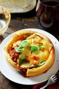 Pizza Bowls with tomato sauce, sausage, and two types of cheese