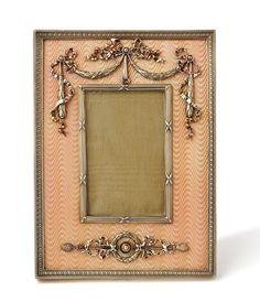 A silver gilt photograph frame by Carl Fabergé, of rectangular form enamelled…