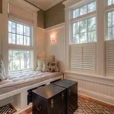 3/4 wall height beadboard, thick top window crown headers, half cafe plantation shutters, built-in seating with storage underneath.  Lots of ideas here.