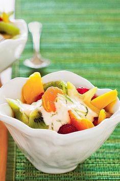 Light sour cream and light mayonnaise make up the lime-flavored topper for this fresh fruit dessert. Enjoy it for a snack as well. #salads #saladrecipes #healthysalads #saladideas #healthyrecipes