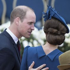The Duke of Cambridge put his hand on the Duchess of Cambridge's back in a tender moment during during the Official Welcome Ceremony. Fans often delight in seeing these candid moments while the couple is on tour. Kate's chic chignon is also on display in the photo. <br><br>Photo: © Christopher Morris/Hello! Canada