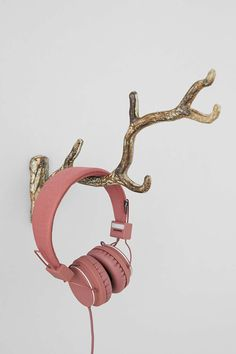 Iron Tree Branch Hook. This is so cute. Could go in a bedroom or anywhere to hold up little items like headphones.