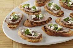 Grilled Pork Crostini with Raspberry Chipotle Sauce
