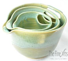 A baker's dream! These pottery mixing bowls come in a set of 3 and nest inside each other for easy storage. Made in America by Maggy Ames Handmade.