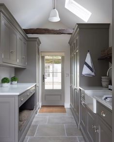 This door to this utility room opens onto the garden behind, so with pets and children hardwearing natural limestone flooring is essential. Boot Room Utility, Utility Room Storage, Dog Storage, Boot Room Storage, Utility Cupboard, Utility Sink, Pantry Storage, Mudroom Laundry Room, Laundry Room Design
