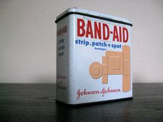 Band-Aids in a metal box.
