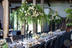 Gorgeous tall centrepieces on floral stands at Stones of the Yarra Valley | Styling by One Wedding Wish