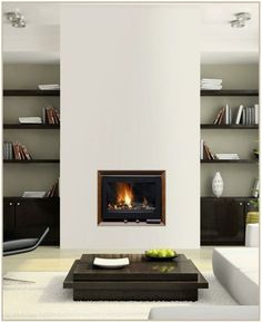 habillage cheminée moderne design contemporain salon intérieur étagères bois table basse bois canapé blanc tapis de sol blanc