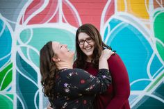 LGBT couple laughing together in front of a mural for their engagement photography session in downtown Phoenix at Roosevelt Row. LGBT and Same Sex Engagement Session Engagement Couple, Engagement Session, Roosevelt Row, Couple Laughing, Lgbt Couples, Downtown Phoenix, Adventure Photography, Arizona Wedding, Phoenix Arizona