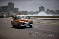 Stock Photos/Pictures: A classic Chevrolet drives along El Malecon while waves crash - Havana, Cuba Cuba, Old American Cars, Classic Chevrolet, Old Cars, Vintage Cars, Chevy, Classic Cars, Trucks, Stock Photos