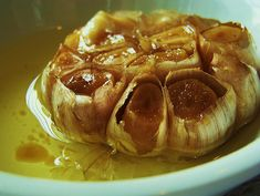 Roasted Garlic.    I use much less olive oil than Geri... wrap garlic in foil, cover top with light coating of olive oil, salt  pepper and then pop in the oven. AMAZEballs on bread, pasta, pizza. or honestly, alone :)  make sure your honey has some too though, give killer breath.