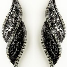 "These artistic hematite plated black crystal rhinestone dangle earrings are a fabulous choice for weddings, proms, homecomings or any special occasion in need of some extra color and sparkle! They feature a creative hematite plated twist design adorned with glittering smoked and jet black crystal rhinestones.  Size: 3.25"" long x 0.375"" wide"