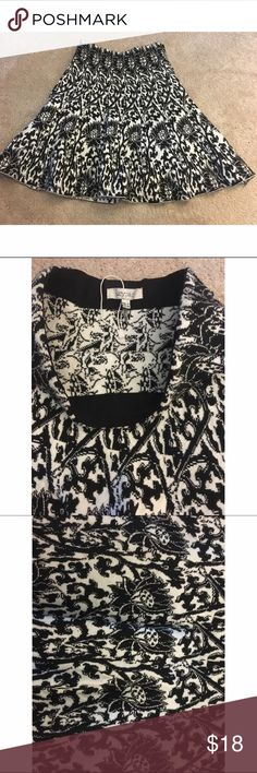 Fit and flare skirt Black and white fun print. Hits mid thigh. Fitted at the waist (high waisted) and flares at the hips. Great fit. Good quality. Knit Lucy paris Skirts Circle & Skater