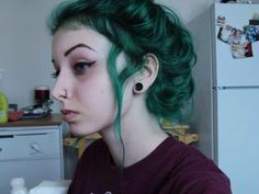 edgesofmysanity: iamchantie: dramatic self-portraits in my kitchen tbh i am so gonna dye my hair in alpine green again ohgod