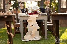 most amazing dinner table ever using vintage book pages as table runner. lots of other beautiful displays with books too.