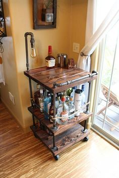 Our beautiful, handmade, solid wood and steel bar cart has been very popular for us and people love it! We now offer the same awesome bar with the addition of industrial lighting to it!   Featuring 3 levels of solid wood linked together by black pipe the cart is both usable and display worthy! The bottom level holds is the wine rack holding up to 12 bottles and just as many glasses. The middle level features our own design rope barrier that is not only useful, but adds a warm touch to the…