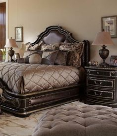 Leather Bed With Satin Coverlet And Decorative Pillows