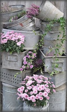 Industrial buckets, baskets, and drawers make excellent planter boxes! #garden #gardening #spring
