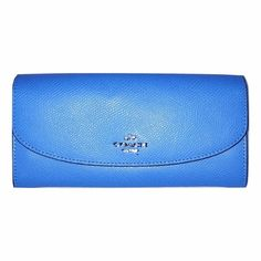 COACH NWT Wildflower Pop Slim Zip Envelope Wallet COACH Brand-new with tags!!! Coach Wildflower pop slim Zip envelope wallet.  pretty baby blue color.  Check out my spot for listing on the matching bag in pic 4!Description: Wrapped Coach's signature coated canvas, slim envelope style wallet w snap flap closure w Coach logo accent. INT feat. (12) credit card slots, bill compartments and a zippered coin compartment. The back features an open slip pocket along with a removable zippered pouch…