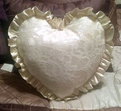 My cousin had this pillow made from her Mothers's Wedding Gown.  I thought it was a such an awesome idea.