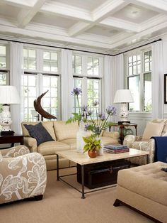 Living Room with Custom Windows A 12-foot-high ceiling leaves plenty of room for tall windows and French doors topped with divided transom windows.