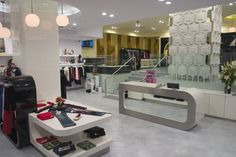 A clothing store featuring stone floors in a styled look. Not to be mistaken with