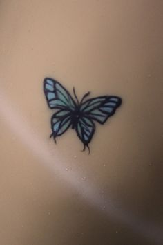 Butterfly tattoo on the hip of a silicone Sinthetics doll