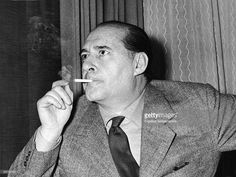 Italian motion picture director <a gi-track='captionPersonalityLinkClicked' href=/galleries/search?phrase=Roberto+Rossellini+-+Film+Director&family=editorial&specificpeople=15285339 ng-click='$event.stopPropagation()'>Roberto Rossellini</a> (1906 - 1977) smokes a cigarette, London, November 27, 1959.