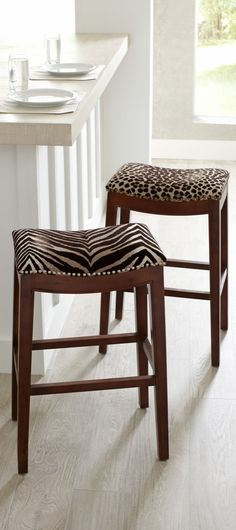 Add some safari chic to your décor with our Serengeti Stools. These leopard and zebra seat covers look like genuine hides-but they're made of fabric, not fur, with the feel of soft velveteen. Mix or match; they add a fun, adventurous look to any room. Animal Print Furniture, Animal Print Decor, Animal Prints, British Colonial Decor, African Home Decor, Home Decor Inspiration, Bar Stools, Decoration, Living Room Decor