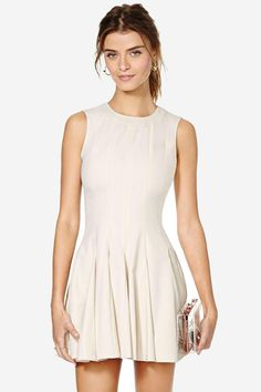 Work it out in this awesome nude dress featuring pleated detailing at skirt, a scoop neckline, an...