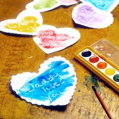 This cute Valentine's Day crafts is an art project and fun activity all rolled into one! Simply cut hearts from white paper and write love notes on them with a white crayon before your kids get up in the morning. Hide the hearts in strategic locations, place a box of watercolors at the breakfast table, and let your little ones brush paint over the hearts to reveal the sweet Valentine's Day messages.