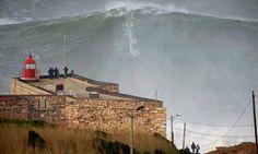 Garrett McNamara surfing a giant wave in Nazaré Portugal
