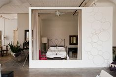 My Houzz: International Meets Industrial in a Brooklyn Loft - industrial - Bedroom - New York - Chris A. Dorsey Photography....ceiling fan in your closet/bedroom????????