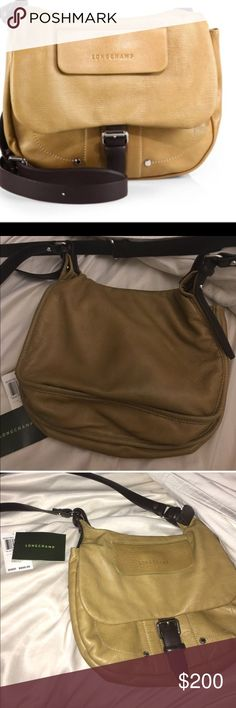 LongChamp crossbody Few signs of use to the back side of bag, you can see a very faint bluish tint on the top of the back of the bag from denim wearing off (see second pic)..In great condition! Longchamp Bags Crossbody Bags