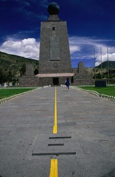 The huge Equator Line Monument in Mitad del Mundo (middle of the world), Quito. The yellow line marks the north and south hemisphere (north is on the left).