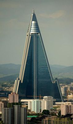 "Ryugyong Hotel - 330 metres    North Korea's notorious Ryugyong Hotel (above) is finally due to complete in 2013, 24 years behind schedule, and takes seventh place on our list. Nicknamed the ""Hotel of Doom"", the 330-metre pyramidal building in Pyongyang was first under construction in 1987. Building work stopped in 1992 after the collapse of the Soviet Union placed the city in an economic crisis and didn't resume until 2008."