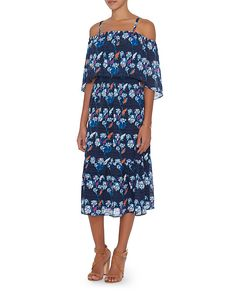 Tanya Taylor Amara Floral Print Dress: Floral fresh print enlivens this midi dress. Adjustable straps. Elasticated neckline and empire waist. Ruffled hem. Lined. In navy. Fabric: 100% silk Lining: 100% polyester Made in China. Model Measurements: Height 5'8.5 ; Waist 24 ; Bust 33 wearing size ...
