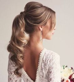 soft curly ponytail with a bouffant