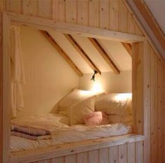 I like how this bed is tucked away. Could add a curtain across entrance. Would totally do it if I had a cabin