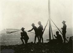 Members off Signal Corps 29 Division in training at Camp McClellan, Alabama using sempahore flags, 1918.