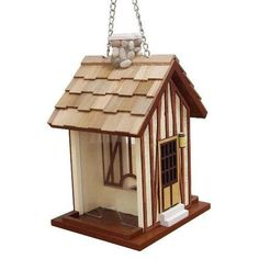 Wrens will flock to this Hamlet French Cottage bird feeder. Victorian Cottage, French Cottage, Outdoor Christmas Decorations, Light Decorations, Garden Decorations, Bird Tables, Glass Hummingbird Feeders, Decorative Bird Houses, Stucco Walls
