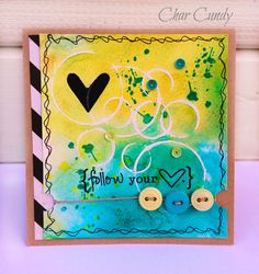 """""""I started  by embossing the circles with white embossing powder and then water colored over the embossed circles. Then I stamped the splatters with the stamp set, finished off stamping the hearts and sentiment."""""""