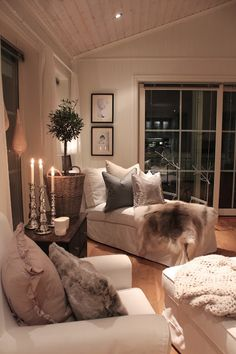 white and neutrals with various textures, dark wood and pops of metalic. Serene.